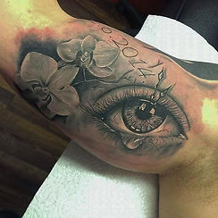 eye and orchids tattoo tetovaza