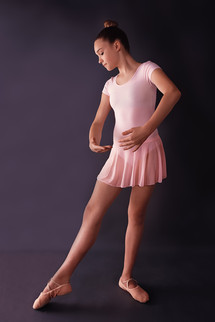 Teen Modeling Portfolio Headshot Session at a Gibsonia, Pennsylvania photo studio. The girl wears ballet slippers a pink dance leotard.