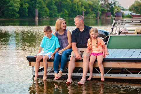 A family of 4 from Oakmont, PA, relaxes on their Allegheny River boat dock for their Lifestyle Photography Session.