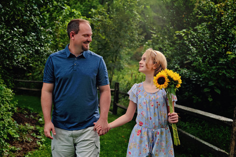 Lifestyle Family Session with a tween girl and her father walking through a Western Pennsylvania forset holding hands.