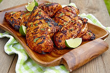 Grilled chicken breast served with herbs