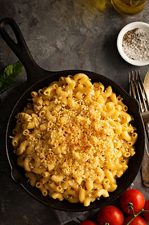 Mac and cheese in a cast iron pan baked