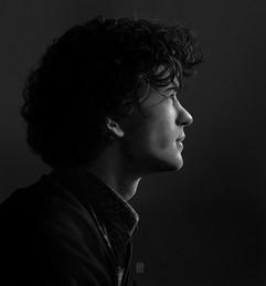 man-curls-profile-portrait-painting