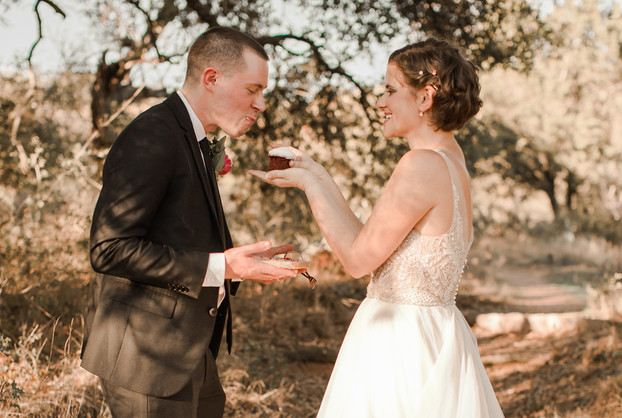 Feeding Each other cake at elopement
