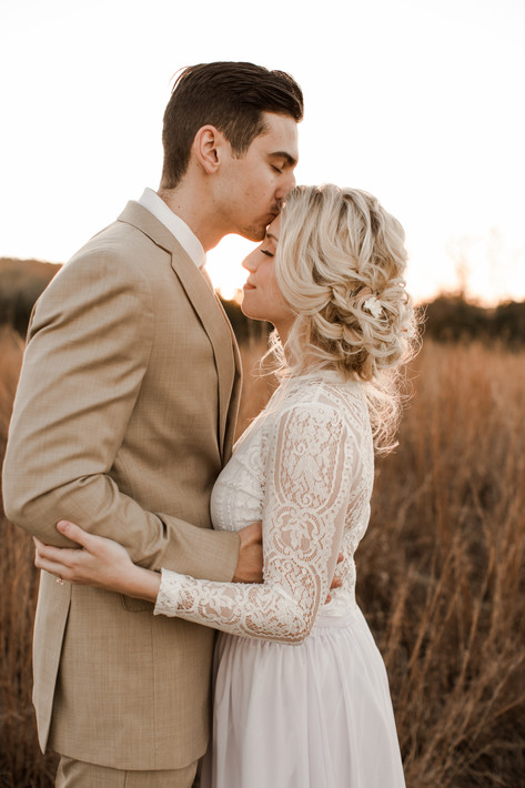 Commons Ford Elopement Forehead Kiss.jpg