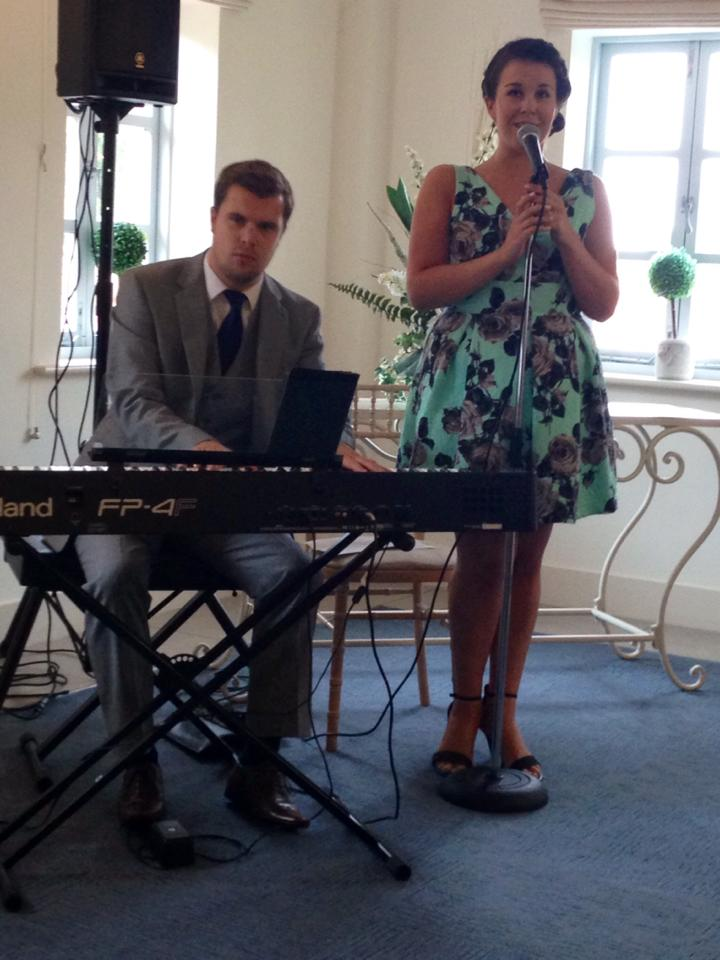 Performing with singer Emma Dean
