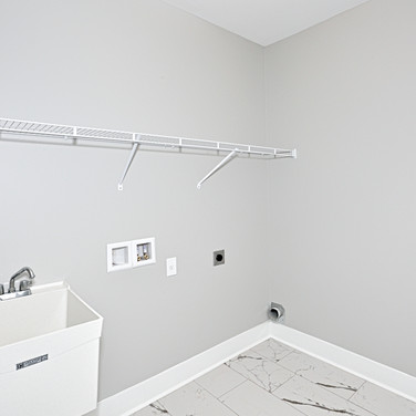 The Bethany laundry room with shelving and sink.