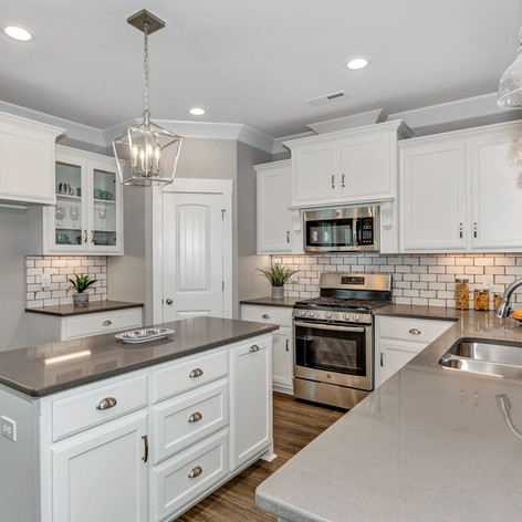 The gorgeous kitchen with island in The Clover.