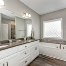 Large master bath with double sinks in The Clover.