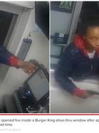 Woman opens fire through Burger King Drive thru Window.