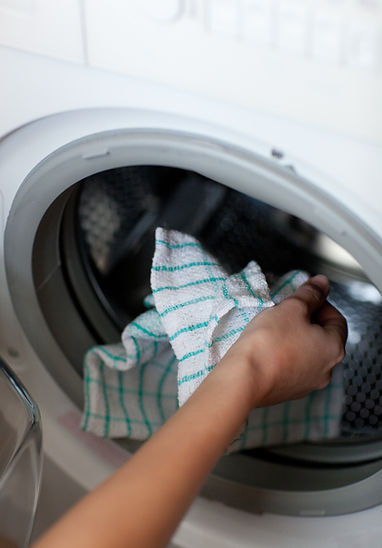 close-up-of-a-woman-doing-laundry-PHMUY5