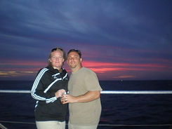 couple in key west, florida with the sunset in the background