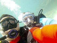 couple scuba diving underwater taking a selfie