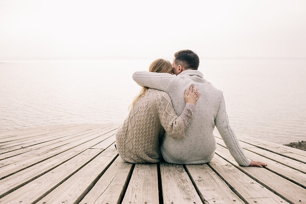 couple hugging on a pier.jpg