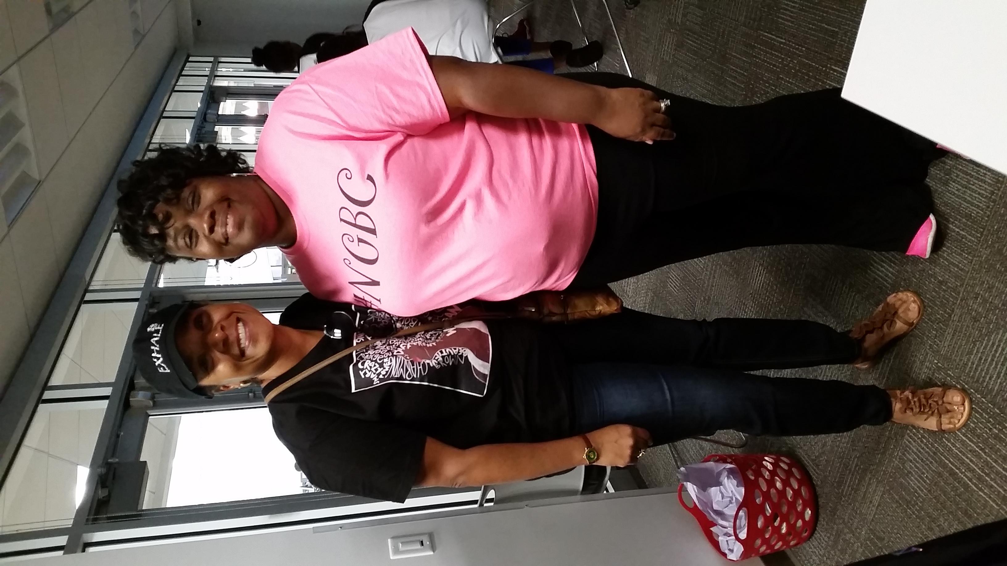 at in pink shirt