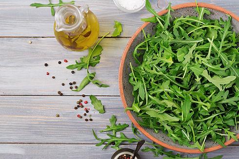 fresh-leaves-arugula-bowl-light-wooden-b