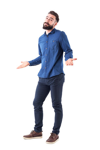 Puzzled confused man in blue shirt shrug