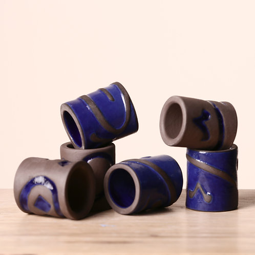 Napkin rings with calligraphy