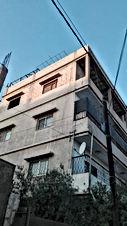 عمارة للبيع في الزرقاء حي الاسكان مكونه من اربع شقق ثلاث جاهزات والرابع عظم