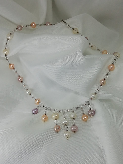 Handmade Multi coloured freshwater pearls, crystals and silver beads form a full necklace