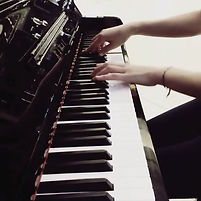 hands on piano keyboard Raj Avtar Kaur