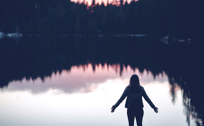 silhouette of person standing beside body of water_edited.jpg