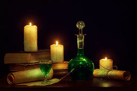 Magic potion, ancient books and candles.