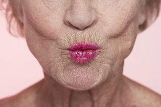 senior-woman-puckering--close-up-of-mouth-sb10063885x-001-aa9a85159dca43a4a11d340570ae8882