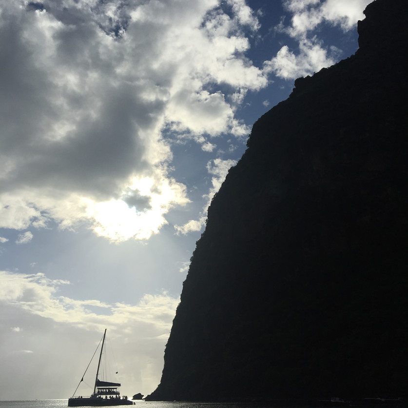 A sailboat moored at the base of Petit Piton