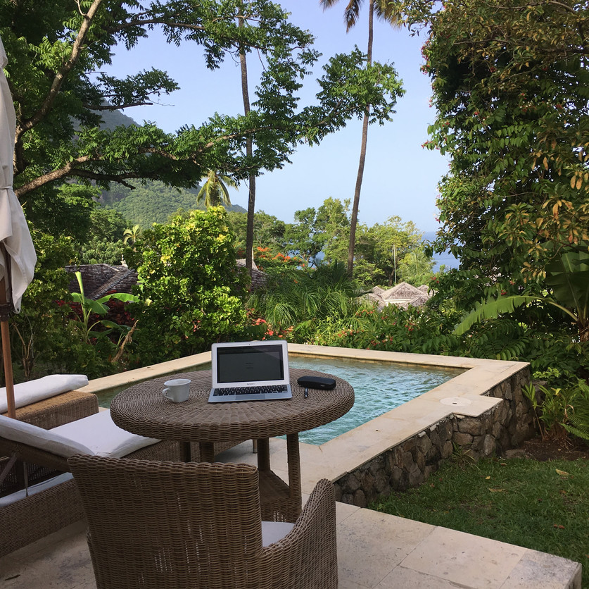 Charlie's work station outside of Villa 306 at Sugar Beach Resort. Pitons Bay in the Distance.