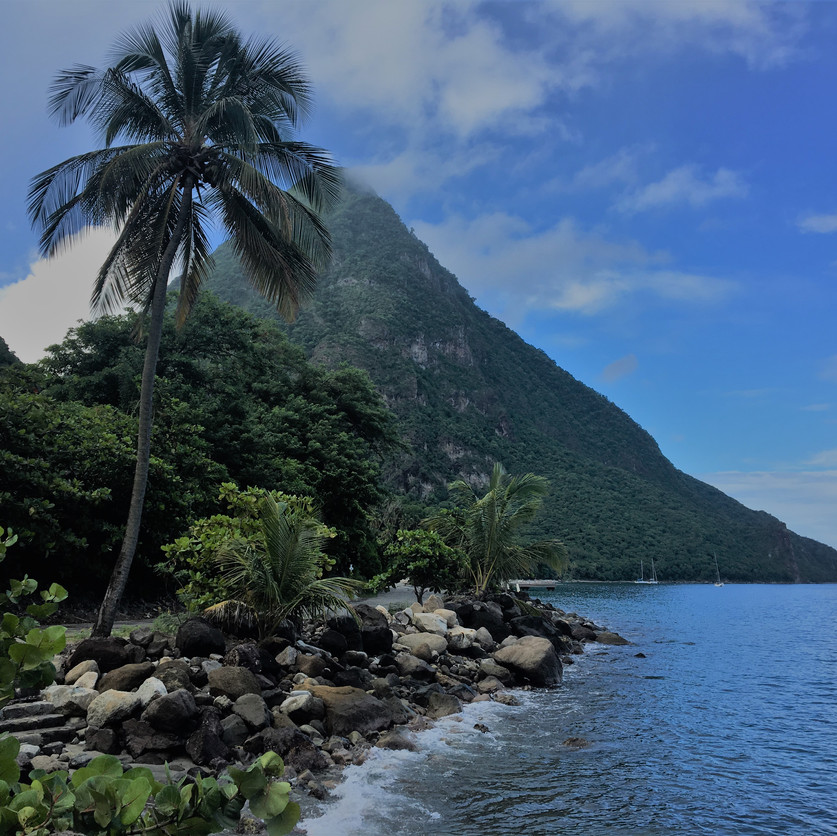 Gros Piton. Soufriere Bluff, where Julian Crist is killed, is visible just to the left of the sailboat.
