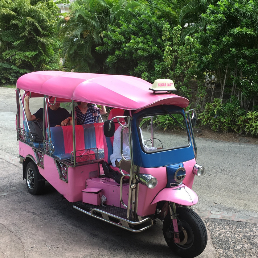 Colorful Tuk Tuk Taxi.  Mode of transportation at Sugar Beach Resort