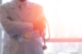 photo of doctor wth stethoscope in front of a window
