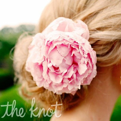 A Single Pink Peony Worn In The Bride's Up Do