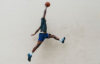 Basketball player training on a court in
