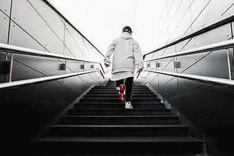 man climbs the stairs. Urban wallpaper.
