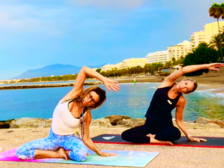Sunrise yoga on the beach in Marbella