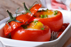 Tasty Appetizer Of Baked Tomatoes Stuffed With Eggs.jpg