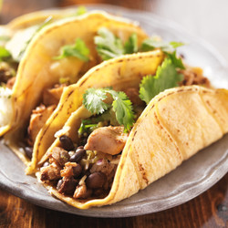 authentic mexican tacos in yellow corn shell with chicken.jpg