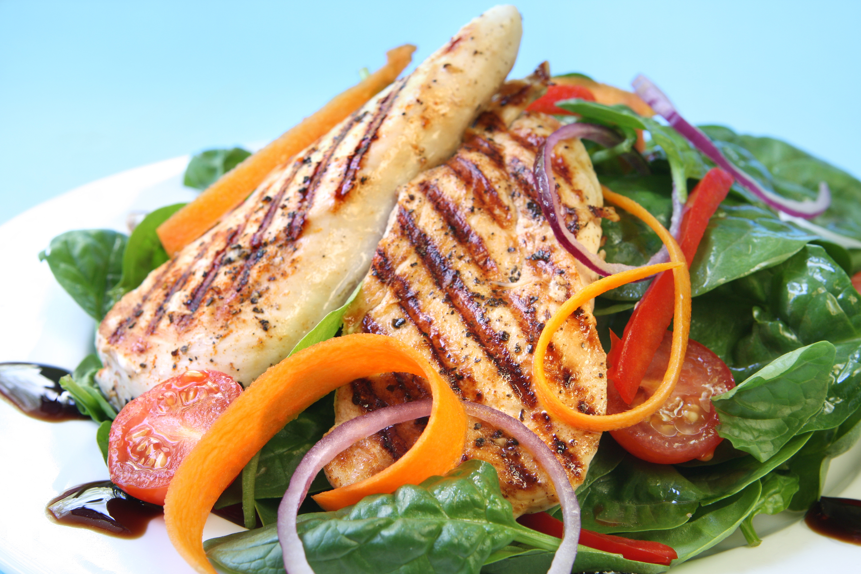 Grilled chicken breast with a spinach salad, with a balsamic reduction..jpg