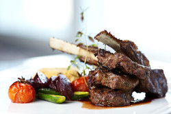 Grilled lamb carre with warm couscous salad, roasted vegetables, Dijon mustard a