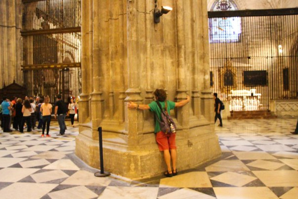 Hugging an enormous pillar in the cathedral