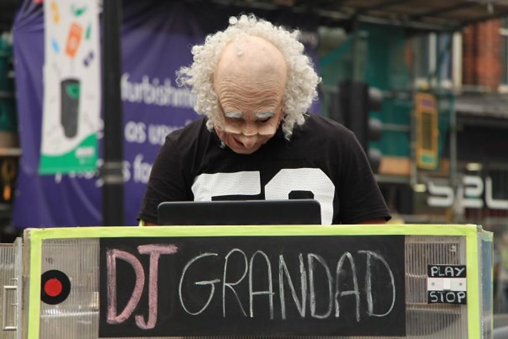 Street DJing in a mask