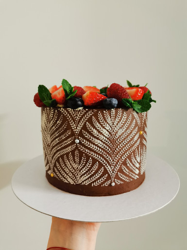 Floral stencil chocolate cake with berries