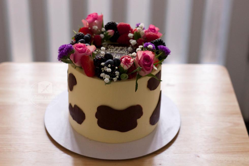 Chocolate 'Moo' cake with fresh flowers