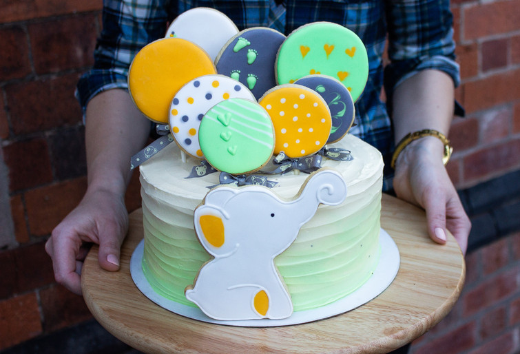 Baby shower cake with hand-crafted sugar cookies