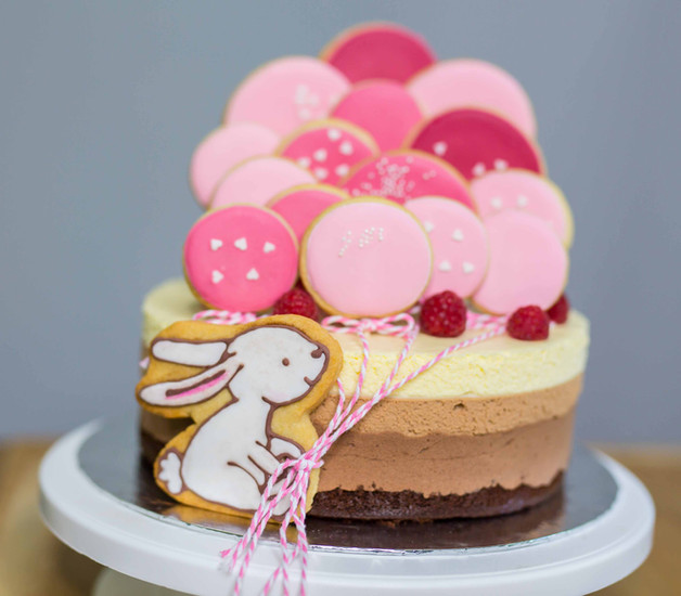 Baby shower cake with pink sugar cookies
