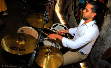 Talented professional Drummer in Oman Ernesto Raymat Pulse and Soul band Latin sands band Tunes Oman Teacher at classic music and arts institute Oman muscat musicians.