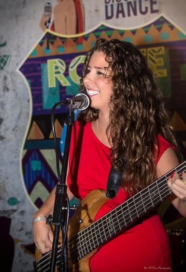 Claudia Reynaldo Prado Bass player ltd guitar Oman Muscat Pulse and Soul Live band Bass player Muscat Oman Gulf Dubai Band