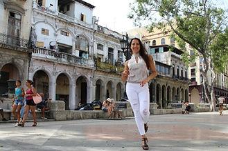 Melissa Mansfield dances down El Prado in Havana, Cuba